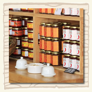 products on shelves and taster bolws at the South Devon Chilli Farm shop